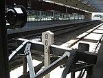 Aeropuerto Barcelona, interior de la estación de trenes, punto kilométrico en guardachoque.JPG