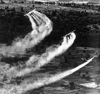 Three US Fairchild UC-123B aircraft spraying Agent Orange during the Operation Ranch Hand as part of the overall herbicidal warfare operation called Trail Dust with the aim to deprive the food and vegetation cover of the Viet Cong, c. 1962-1971. Agent Orange Cropdusting.jpg