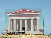 Reconstruction of original painted state on a scaffolding covering the Temple of Concordia, Akragas.