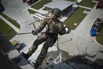 Airmen from the Oklahoma Air National Guard's 138th and 137th Security Forces Squadrons perform rappelled descent maneuvers (29648872340).jpg