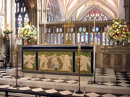The altar in St. Mary Anglican Church, Redcliffe, Bristol. It is decorated with a frontal in green, a colour typically associated with the seasons after Epiphany and Pentecost. Note the reredos behind the free-standing altar. Altar.stmaryredcliffe.arp.jpg