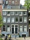 foto van Twee huizen achter gezamenlijke gevel onder rechte lijst met dakkapellen