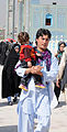 An Afghan father carries his child at the Blue Mosque.jpg