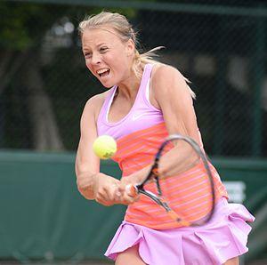 Anett Kontaveit - Kontaveit swinging a backhand