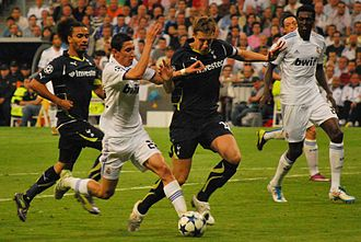 Ángel Di María - Di María taking on Tottenham Hotspur defenders Benoît Assou-Ekotto and Michael Dawson in the Champions League in April 2011