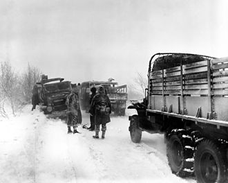 2½-ton 6x6 truck - U.S. Army vehicles on a road in Belgium, 19 January 1945