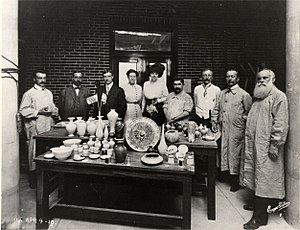 Frederick Hurten Rhead - Frederick Hurten Rhead (at far left) and others at the Art Academy of People's University (now the Lewis Center) in University City, Missouri, celebrating its first high-firing kiln in April 1910.
