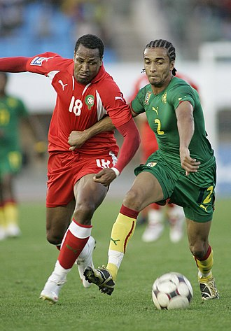 Benoît Assou-Ekotto - Assou-Ekotto (right) playing for Cameroon in 2009
