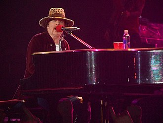 "Axl Rose - Rose performing ""November Rain"" at Nottingham Arena in Nottingham, England, in May 2012"