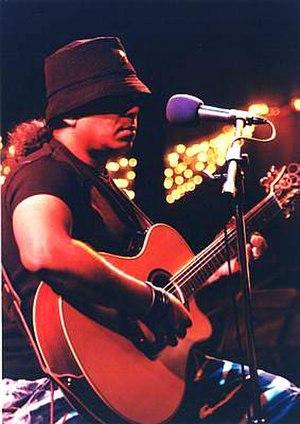 Ayub Bachchu - Bachchu performing at a concert