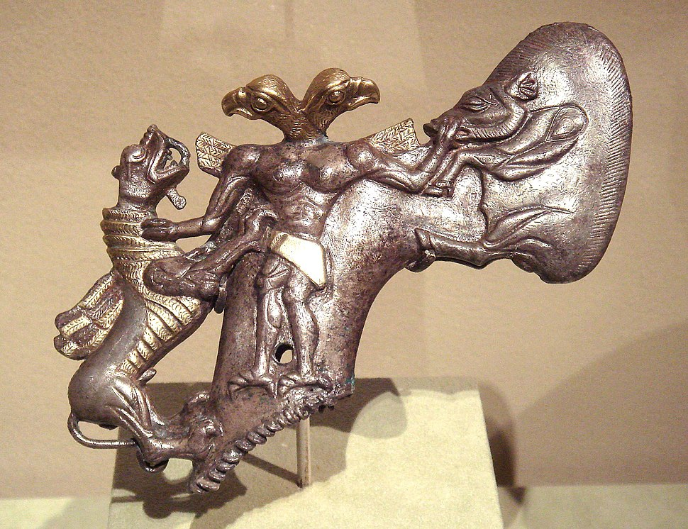 BMAC, Axe with eagle headed demon and animals, 3rd - early 2nd millennium BCE