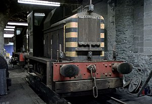 Route availability - Class 01 shunter 01002 inside the shed at Holyhead Breakwater. The withdrawn loco 01001 is just visible at the rear. They had a R.A. of 1 and so had the least axle load related restrictions put upon them.