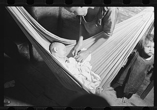 other resolutions  320    225 pixels     file baby asleep in hammock  the hammock saves space in a shack      rh    mons wikimedia org