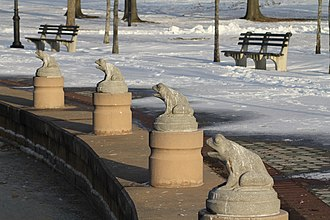 Baisley Pond Park - A row of stone frog statues graces the southeastern shore of Baisley Pond.