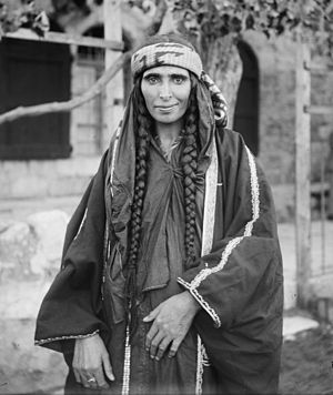 Arab Christian Bedouin woman from the settled town of Kerak, Jordan, who probably was the wife of a sheikh. Braids were predominantly worn by Arab Christian Bedouin women of the tribes of Jordan. Bedouin woman (1898 - 1914).jpg