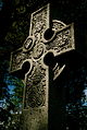 A stone Celtic cross in Beechwood Cemetery