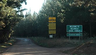State forest - These signs at the entrance to the Belanglo State Forest in Australia advise visitors with instruction and warning.