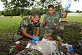 Belize Defence Force combat medics, Lance Cpl. Leon Lopez, left, and Cpl. Paul Shal provide medical attention to a field casualty role player, during a medical exchange, at Price Barracks, in Ladyville, Belize 100830-A-CL600-084.jpg