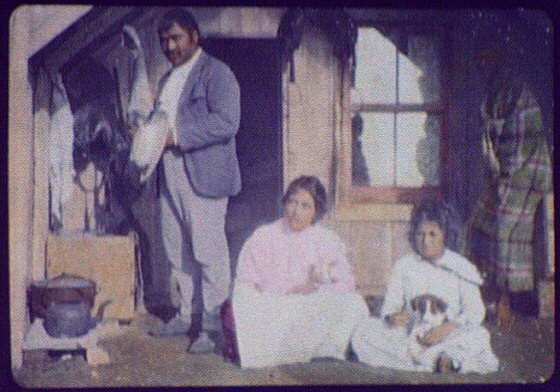 Bella - Maori woman with husband and child and 2 dogs in front of home at Hot Springs LCCN2004707870