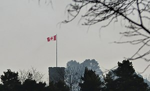 Fort Belvedere, Surrey - Fort Belvedere's tower flying the Canadian flag in January 2014.