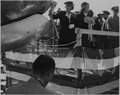 Bess Truman christens an airplane with a bottle of champagne. Margaret Truman is beside her. - NARA - 199103.tif