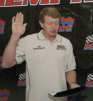 Bill Elliott - Elliott administers the Oath of Enlistment to a U.S. Navy sailor on October 21, 2005.