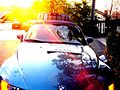 Blue BMW roadster with a broken windshield.jpg