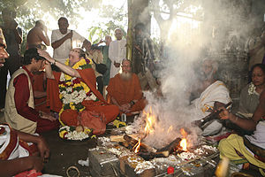 Religious conversion - A yajna initiation to Hinduism ceremony in progress.