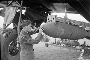 No. 218 (Gold Coast) Squadron RAF - Armourer checking bomb fuzes on 218 Squadron Stirling at RAF Downham Market