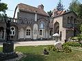 Bory Castle. Front Garden's statues. 'Awakening sunbeam' (left), Head of Jesus (right) and the Ground level (reception) building (eastern facade) - 54, Máriavölgy Rd., Öreghegy, Székesfehérvár, Fejér county, Hungary.JPG