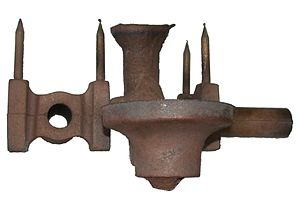 Sprue (manufacturing) - Bronze casting showing sprue and risers