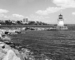 "South Portland Historical Society - ""Bug Light"" with Portland's Eastern Promenade in the background."