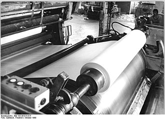Paper machine -  Paper leaving the machine is rolled onto a reel for further processing.