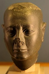 Head of a shaved man-E 25577