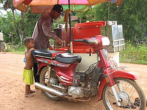 Ice cream van - Motorcycle with attachment for ice cream vending, in Cambodia.