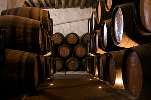 English: Port barrels in a Wine cellar, Vila N...