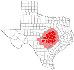 Central Texas counties in red; counties sometimes included in Central Texas in pink