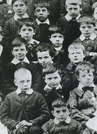 Charlie Chaplin - Seven-year-old Chaplin (middle centre, leaning slightly) at the Central London District School for paupers, 1897