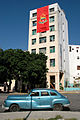 Chevrolet classic car and OPJM building (Havana, Jan 2014).jpg