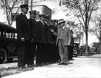Minneapolis Police Department - Chief Frank W. Brunskill inspecting officers at station Number 5 in 1925. Brunskill was also at the heart of Supreme Court case Near v. Minnesota involving Minnesota's Gag Law.