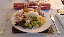 a christmas dinner plate in scotland featuring roast turkey roast potatoes mashed potatoes and brussels sprouts
