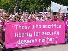 Code Pink activists demonstrate in front of the White House on July 4, 2006.