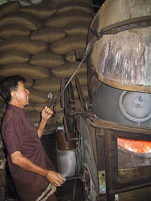 Coffee production in Indonesia - Coffee being roasted at Toko Aroma, Bandung, Indonesia