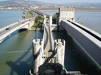 Conwy Suspension Bridge - The bridge as seen from Conwy Castle, with the modern road bridge to the left and the rail bridge to the right