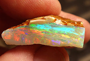 Opal - Multicolor rough crystal opal from Coober Pedy, South Australia, expressing nearly every color of the visible spectrum
