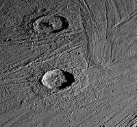 The craters Gula and Achelous (bottom), in the grooved terrain of Ganymede,  with ejecta