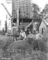 Crew and water tank at camp, Wynooche Timber Company, ca 1921 (KINSEY 1044).jpeg
