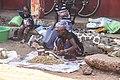 Crouching marketwoman in Senegal.jpg