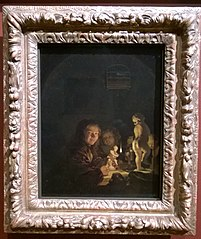 Two boys with plaster statuettes by the light of an oil lamp