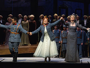 La fille du régiment - Final curtain call of the Metropolitan Opera's 24 December 2011 performance with (l to r) Lawrence Brownlee (Tonio), Nino Machaidze (Marie), and Ann Murray (Marquise)